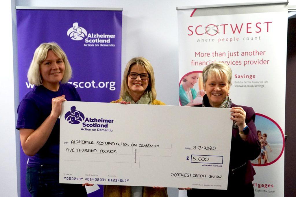 Scotwest presenting Alzheimer Scotland with £5,000 cheque